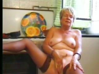 Porno Video of Granny In Stockings Plays In The Kitchen