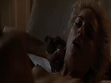Sharon Stone naked lying on her back as a guy kisses her