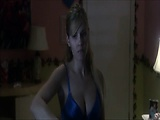 Elisha Cuthbert standing at an ironing board in a blue bra