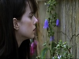 Mia Kirshner giving a blowjob to a guy and then we see her