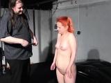 Spanking Redhead Erika in BDSM dungeon
