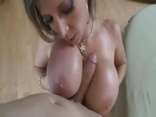 Porno Video of Busty Blonde Sara Jay Plays With Her Tits, Blows And Gives Titty Fuck