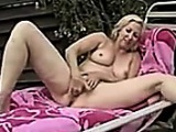 Fingering Her Mature Pussy Outdoors