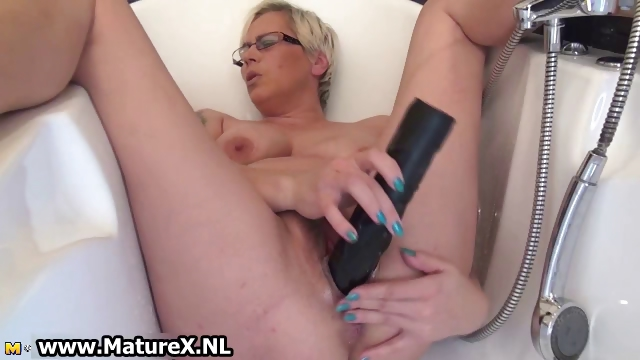 Porno Video of Horny Mature Lady Fucking Her Own Tight