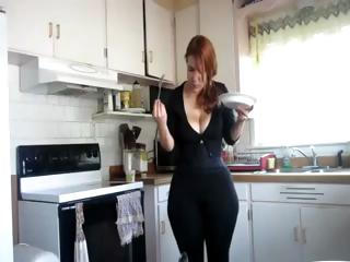 Porno Video of Busty Redhead With A Big Ass Is In The Kitchen Showing Off Her Food