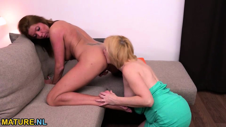 Two matures licking each other out