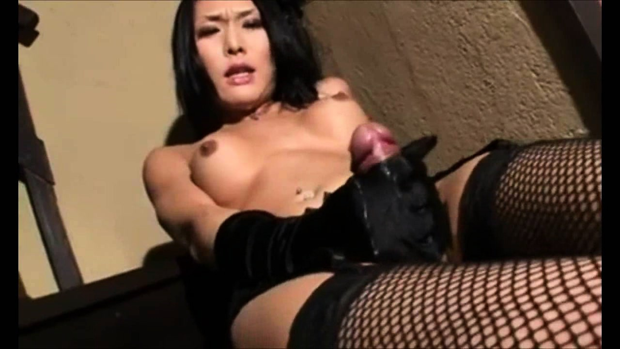 Horny shemale masturbates with her gloves on