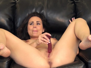 luscious cougar with big hooters holly west has fun with a red dildo