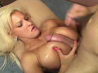 ravishing blonde with amazing big hooters marilyn enjoys a huge cock