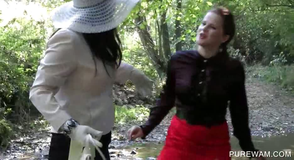 Porno Video of Lesbo Clothed Sluts Get Wet In The River