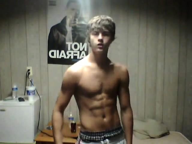Teenboy flexes his muscles