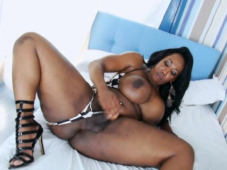 phat booty ebony shemale jerks off her hard cock in bed