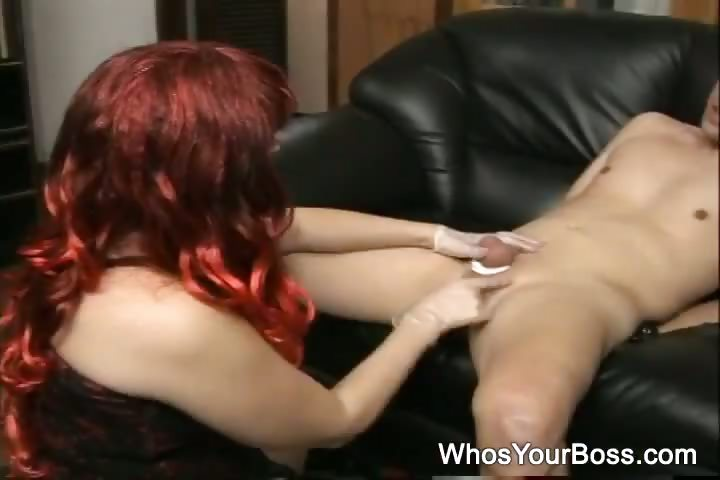 Porn Tube of Redhead Femdom In Black Leather Boots Tortures A Submissive Guys Cock