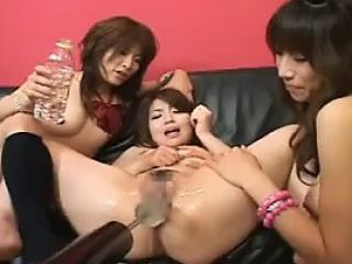 asian lesbians play with each other on the couch then toy t