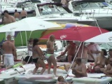 Naughty brunette strips at the beach