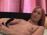 Teen with pink hair plays with her toy