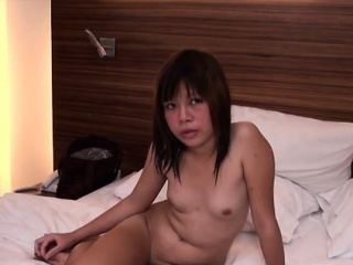 curious babe plays with a big penis and likes to sit on it