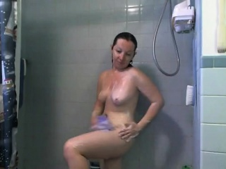 brunette redhead with big tits shaving in the shower