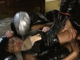 Ebony slut in latex takes two white schlongs
