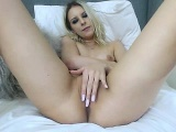 Blonde Babe in White Nylons Fingers Her Pussy Solo