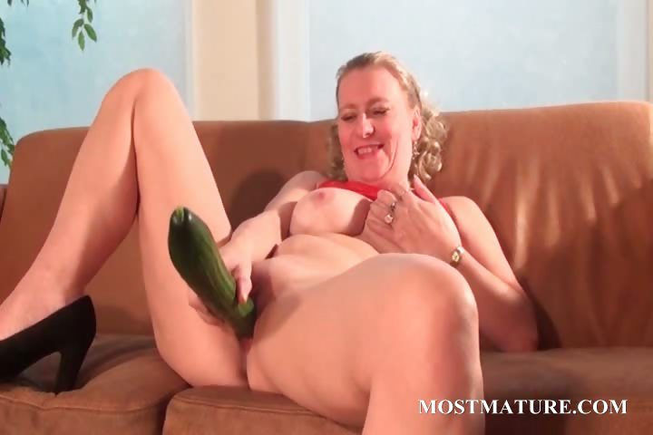 Porno Video of Mature Blonde Masturbates With A Cucumber