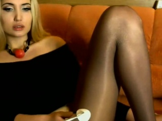 Blonde In Pantyhose With A Cut Hole Fucking Her Pussy
