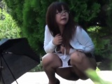 Asian babe pees outside