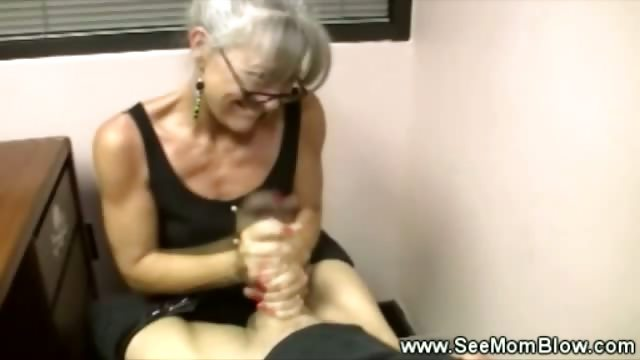 Porno Video of Sexy Granny Wearing Spex Tugs Cock For This Lucky Guy