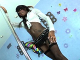 Black shemale beauty tugging fat cock