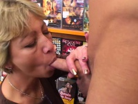 Excited blonde mature fucks him in the video store | Porn-Update.com
