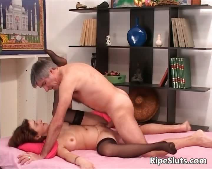 Porn Tube of Brunette Mature Slut Spreads Legs Wide
