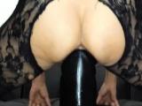 Sarah fucks her loose pussy with a gargantuan dildo