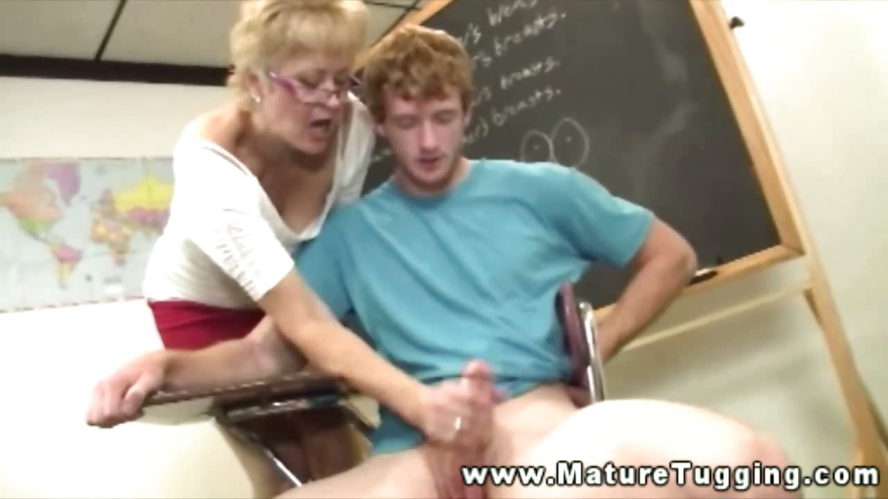 Porn Tube of Blonde Mature Teacher Beating Student In Class Room