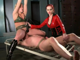 Slave gets spanked by two kinky dominas
