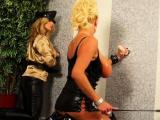 Horny slut sucks fake knob at gloryhole and gets tits slimed