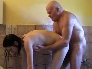 Porn Tube of Young Brunette Helps Grandpa Take A Shower And Dries His Cock With Her Mouth