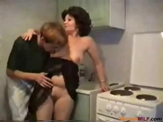 Porno Video of Plumper Brunette Mom Gets Nailed By Her Son Friend In The Kitchen
