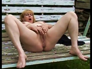 Sex Movie of Redhead Granny Licks Her Tits And Masturbates Her Hairy Snatch In The Garden