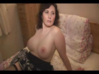 Porno Video of Mature Amateur Brunette Strips In The Kitchen And Poses On The Bed For Hubby