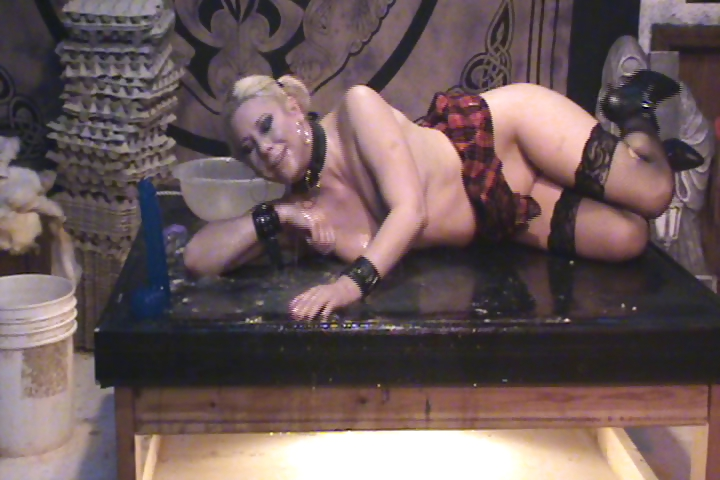 Porno Video of Blonde On A Platform Masturbating And Drinking Slimy Mess
