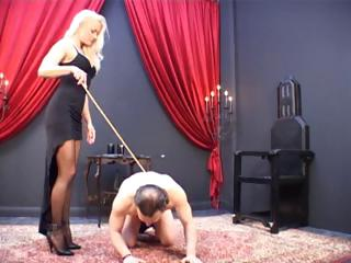 Porn Tube of Blonde Mistress Has Her Slave On The Ground And Is Caning Him