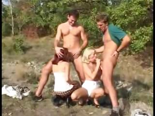Porno Video of Hot Redhead And Blonde Gals Hook Up With Two Dudes In The Woods