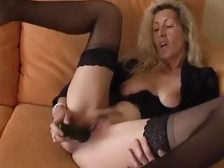 Porn Tube of Nasty Mature Blonde Spreads Her Pussy Lips And Stuffs In A Dildo