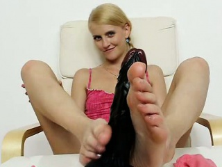 leggy blonde babe performs a sexy bare feet show on the