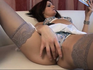 slut in stockings plays with her pussy
