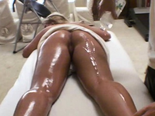 wicked blonde with huge cans rubbed down on massage table