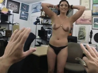 pretty brunette stirpping down naked in back of pawn shop