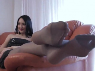 sexy girl shows off her feet and nylons