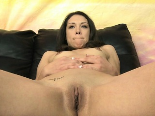 brunette cutie shows her small tits and meaty pussy