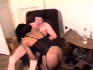 this beautiful young african babe in lingerie bends to blow